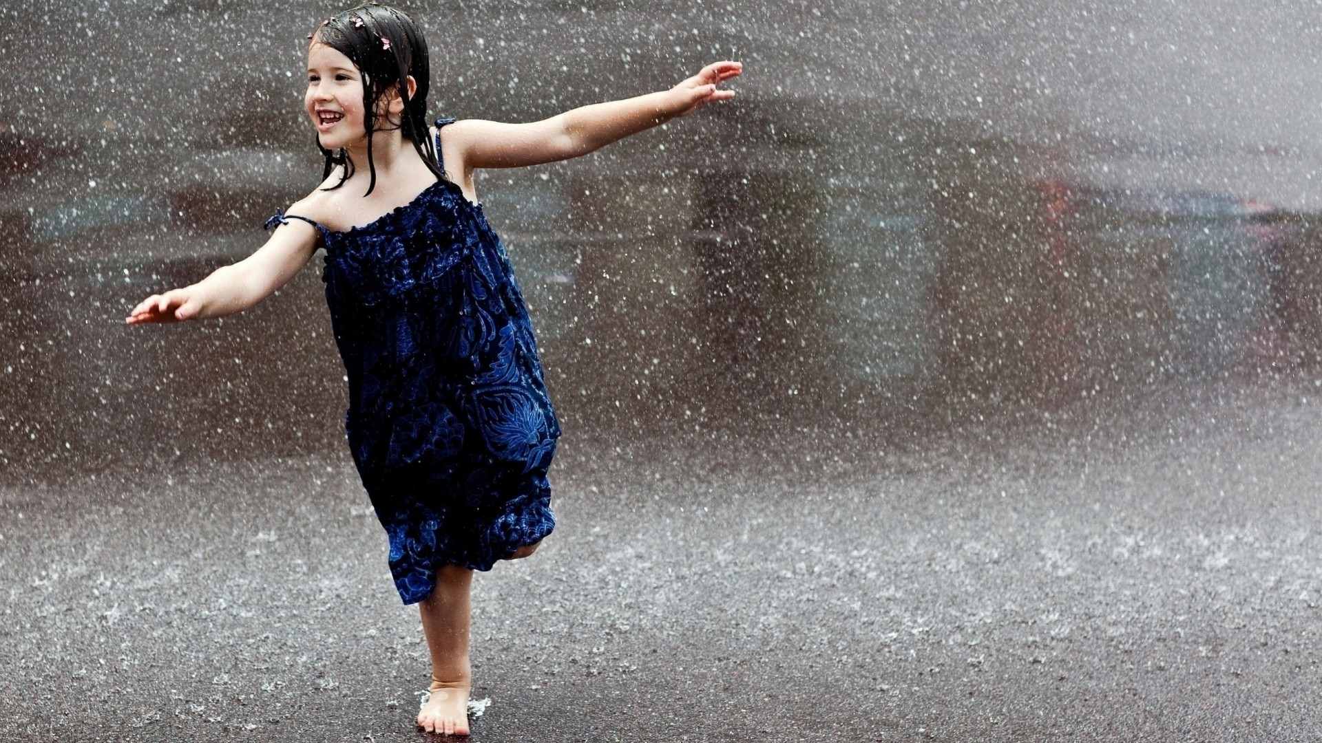 happiness wet girl rain blue dress brunette road falls barefoot child laughter