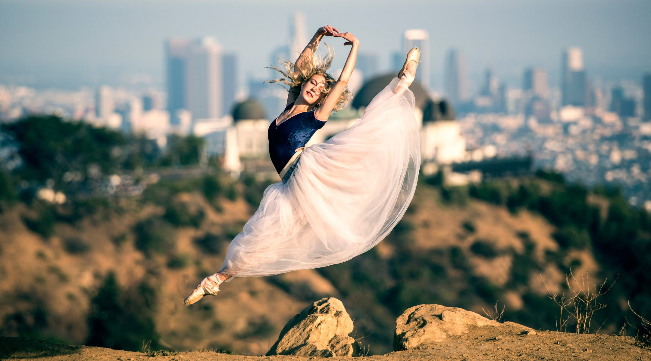 beautiful ballet ballerina pointes dress jump in the background town