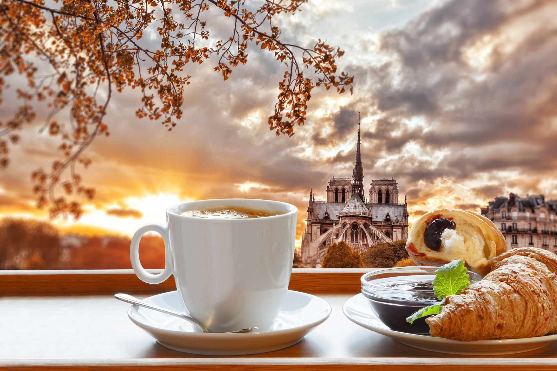 breakfast coffee cup croissant paris france notre dame cathedral jam